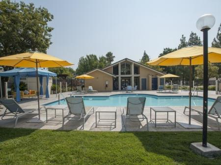 Residents Tanning by the Pool | Davis Apartments | The Edge