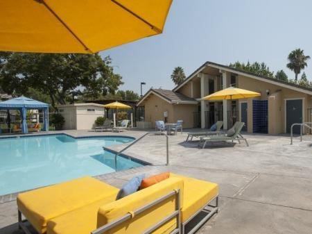 Residents Lounging by the Pool | One Bedroom Apartments In Davis CA | The Edge