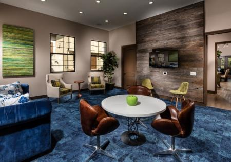 Residents Relaxing in Club Room | Apts In Corona CA | Encanto at Dos Lagos