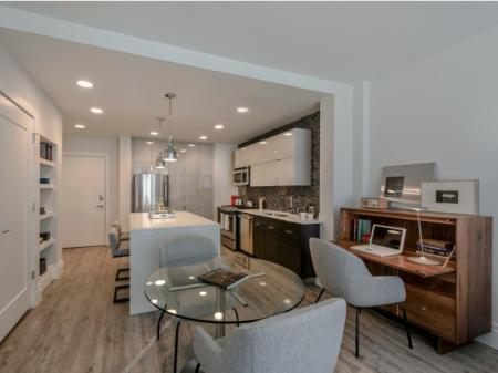 Residents Lounging in the Living Room | Apartments In Bethesda | Pallas at PikeRose