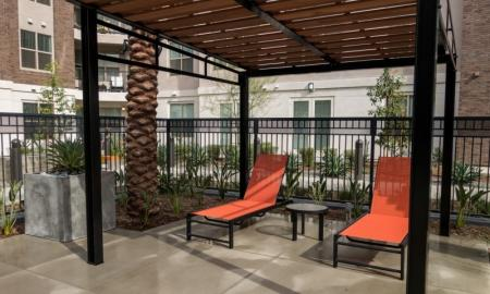 Lounging by the Pool | Apartment In Pomona | Monterey Station Apartments