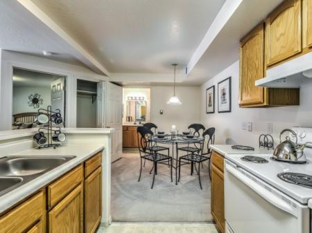 Residents Snacking in the Kitchen | Boise Idaho Apartments | River Pointe