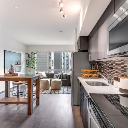 Residents Cooking in the Kitchen | Apartments Bellevue WA | LIV