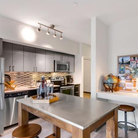 Residents Snacking in the Kitchen | Bellevue Washington Apartments | LIV