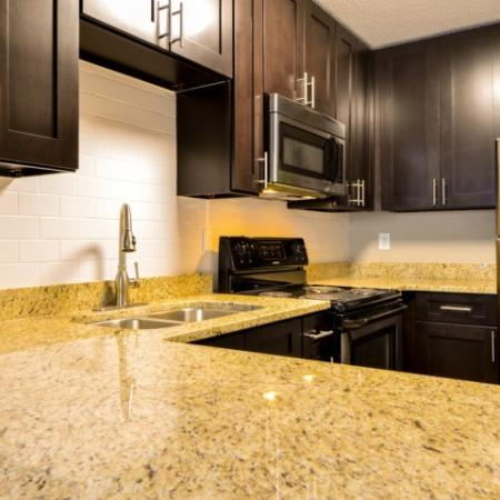 Residents Snacking in the Kitchen | Alpharetta GA Apartments | The Lakes at Windward