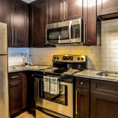 Residents Cooking in the Kitchen | Alpharetta Apartments | The Lakes at Windward