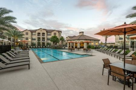 Tanning by the Pool | Apartments Houston | Valencia Place