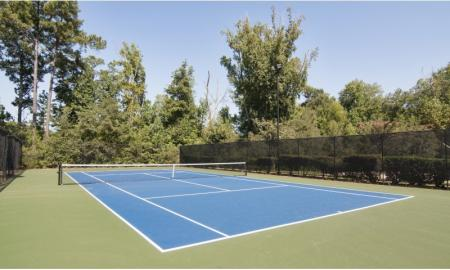 Residents Playing Tennis | Apartments In McDonough Georgia | Amber Chase
