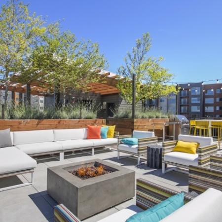 Residents Relaxing on the Sun Deck | Bellevue Apartments | LIV