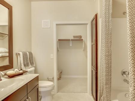 Soak tub and framed mirror | Apartments near TCU and Downtown Fort Worth
