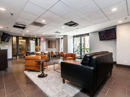Residents Utilizing Business Center | Apartments for rent in Arlington Heights, IL | Hancock Square at Arlington Station