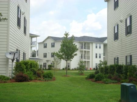 Large amounts of green space lie in between apartment builidngs