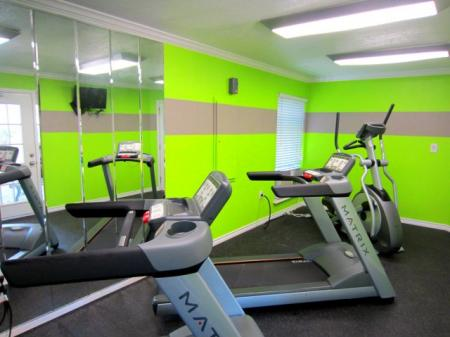 Fitness center with treadmills and ellipticals.