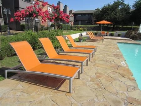 Relax on lounge chairs poolside