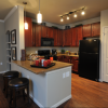 Modern kitchen with granite counter tops and hardwood floors at Kingwood apartments