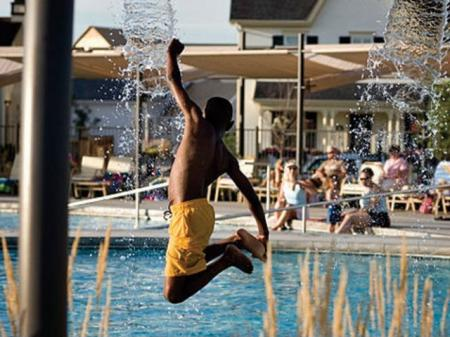 Take a dip in our luxurious outdoor pool as a resident of our Denver apartments at Botanica Town Center