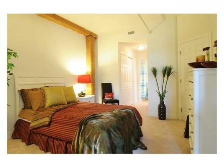 Warmly lit bedrooms in our apartment houses for rent in Richmond VA at Cameron Kinney