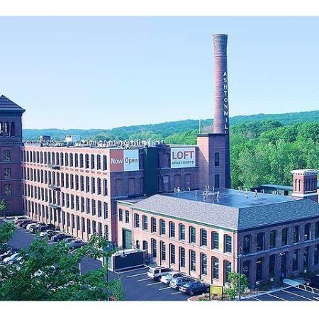 Exterior view of our apartments for rent in Cumberland RI at The River Lofts at Ashton Mill