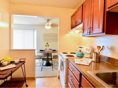 KitchenDining Area | Parma Apartments | Midtown Towers