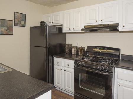 Kitchen with Black Appliances | Landmark at Bella Vista Apartment Homes Duluth, GA