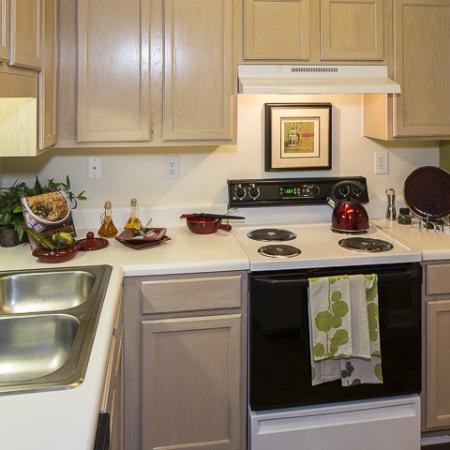 Kitchen with Storage | Caveness Farms Apartment Homes Wake Forest, NC