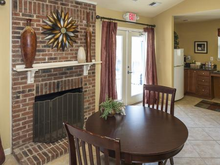 Table by the Fireplace | Caveness Farms Apartment Homes