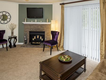 Living Room with Fireplace | Landmark at Chesterfield Apartment Homes Pineville, NC