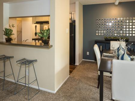 Kitchen with Breakfast Bar | Landmark at Barton Creek Apartment Homes in Austin, TX