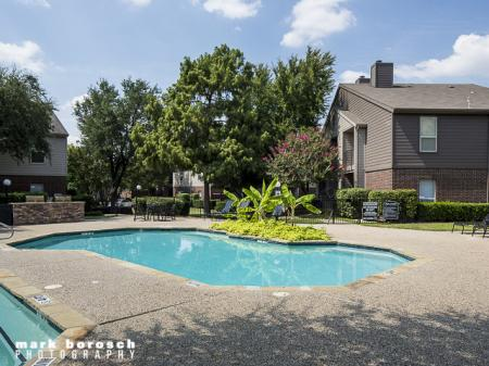 Pool With Landscaping | Landmark at Collin Creek Apartment Homes in Plano, TX