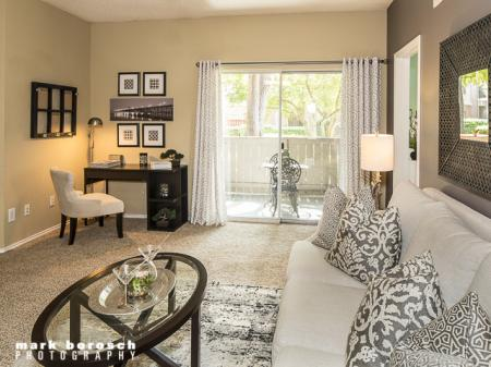 Living Room with Patio | Landmark at Collin Creek Apartment Homes in Plano, TX