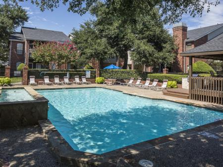 Swimming Pool with Shade | Crestmont Reserve Apartment Homes Dallas, TX