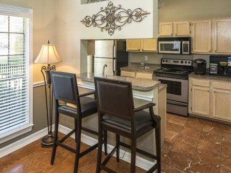 Kitchen with Breakfast Bar | Crestmont Reserve Apartment Homes