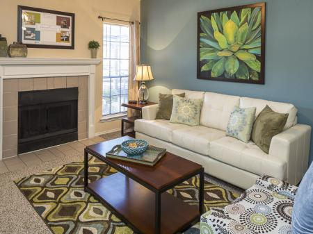 Living Room with Fireplace | Crestmont Reserve Apartments North Dallas, TX