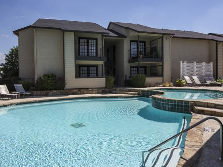 Relaxing Swimming Pool | Kensington Station Apartment Homes in Bedford, TX