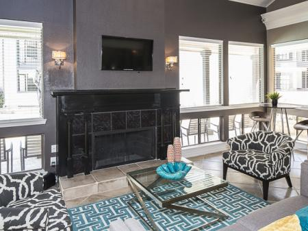 Clubhouse with Fireplace | Kensington Station Apartment Homes in Bedford, TX