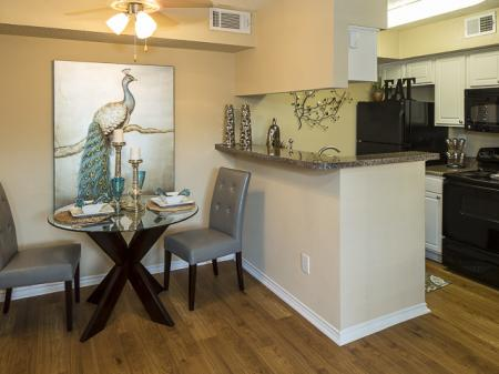 Kitchen and Dining Area | Kensington Station Apartment Homes in Bedford, TX