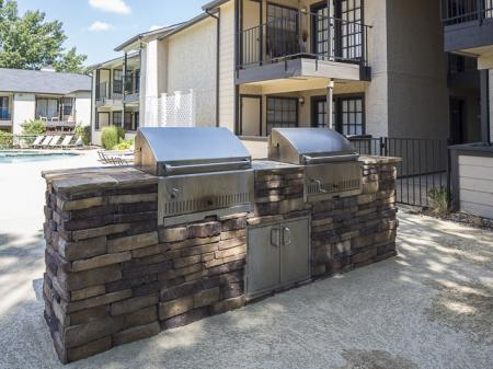 Outdoor Grill Area | Kensington Station Apartment Homes in Bedford, TX