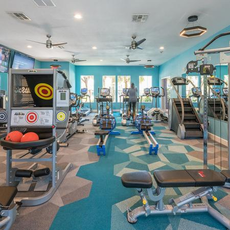 Community fitness center with various exercise equipment.
