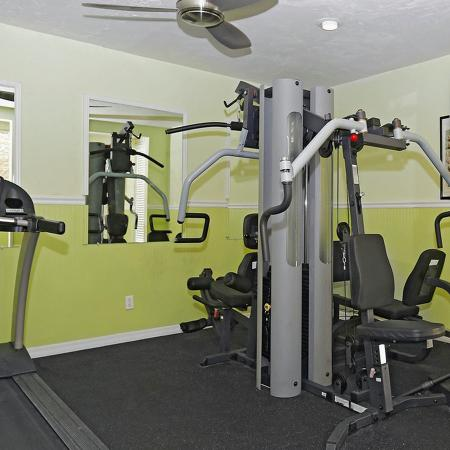Exercise room with various exercise machines.