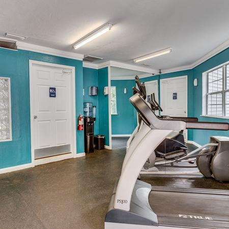Exercise room with several cardio machines.