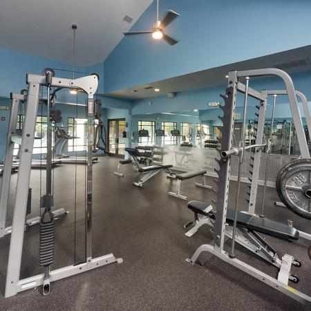 Community gym with weights and treadmills.