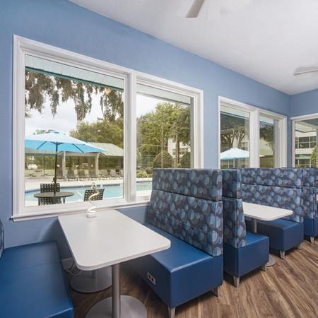 Study with restaurant style booths, overlooking the pool.