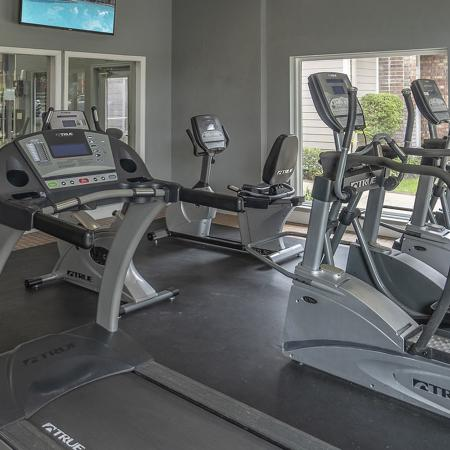 Fitness center with several treadmills.