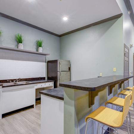 Bar style seating with full kitchen to supply food and drink for social center activities.