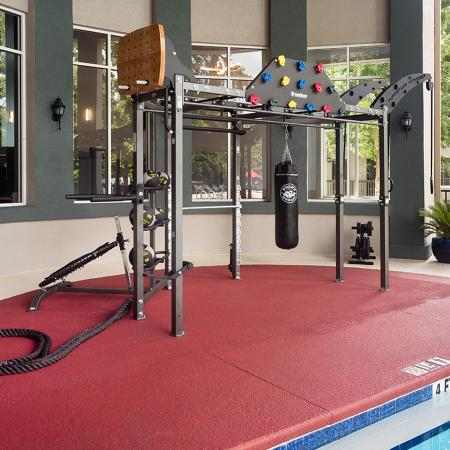 Gym equipment next to the pool.