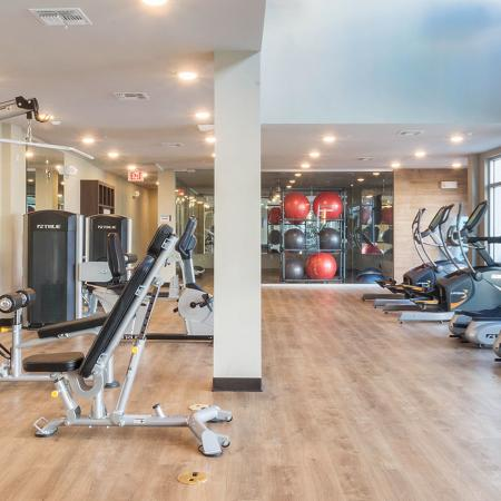 Community fitness center with various cardio and weight machines.