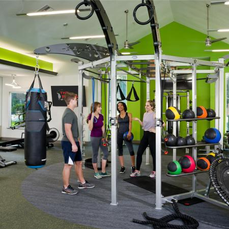 Fitness center view with punching bad, exercise ball area.