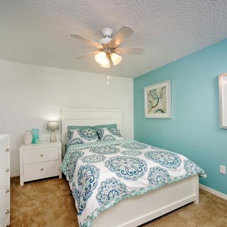 Blue bedroom interior with white furniture.