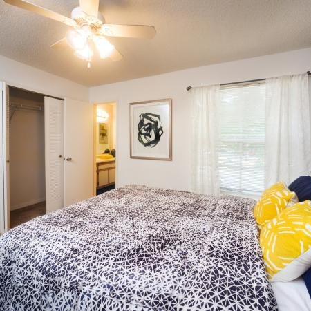 3 bedroom interior with yellow decorative pillows.