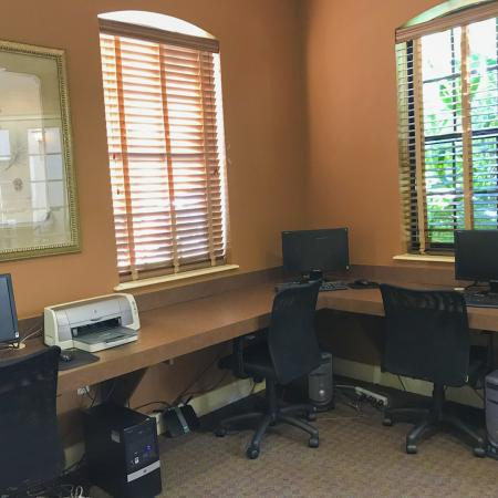 Community computer lab with three workstations and a printer.